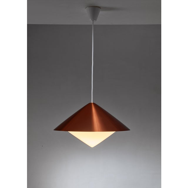 A model 61-343 or 'Kuli' pendant lamp, designed by Svea Winkler for Orno. The lamp is made of a copper colored metal shade...