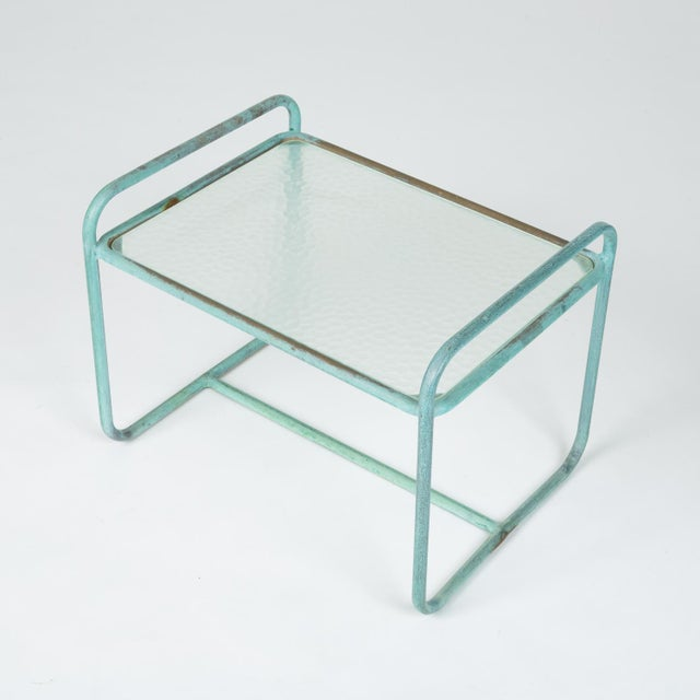 A model BL-3700 patio side table designed by Walter Lamb and produced by Brown Jordan. The table frame is bronze tubing...