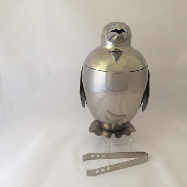 This is a contemporary penguin ice bucket and tongs with a vintage, Art Decor or Mid-Century look. Penguins were a popular...