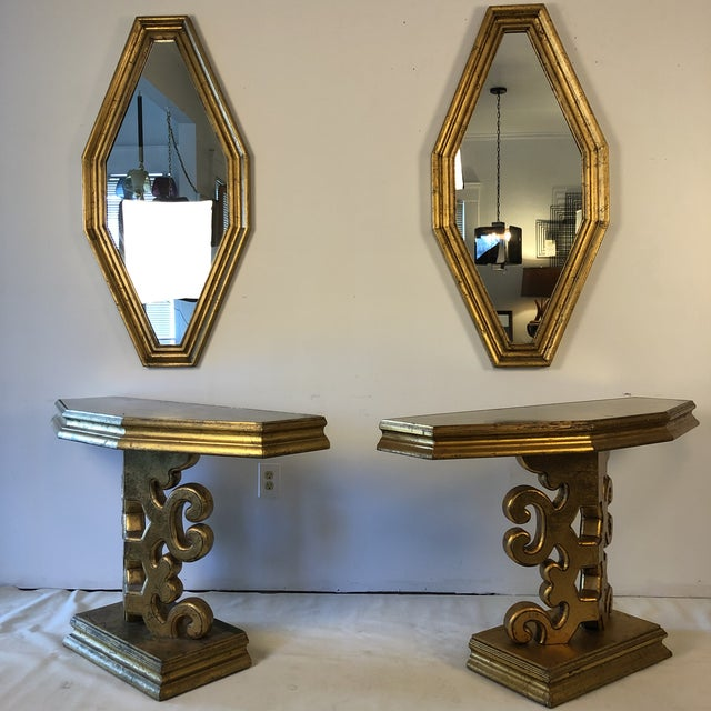 Fabulous gold leaf Hollywood Regency console tables with matching octagonal mirrors in the style of James Mont or Dorothy...