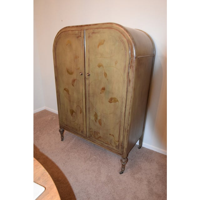 This 1920's radio-style armoire was restored and shelves we added. There are 4 dovetailed drawers and 6 shelves. Great for...