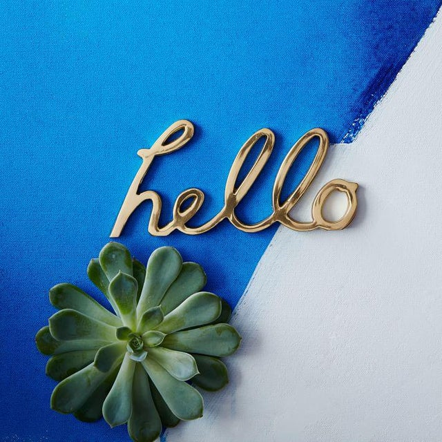 """Solid Brass Word Cursive Art """"Hello"""" welcome sign. Great for office or home. 7 x 3 inches. Excellent pre-owned condition...."""