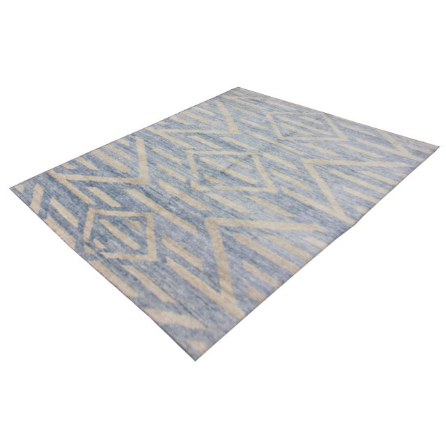 A beautiful handmade Bamboo rug. The geometric design woven in by Aara Rug hands. This rug is made of 75% bamboo silk and...