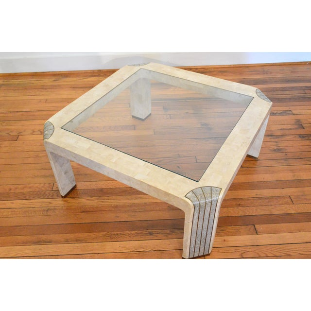 Glass And Tesated Fossil Stone Coffee Table Likely Designed By Karl Springer Or Maitland Smith