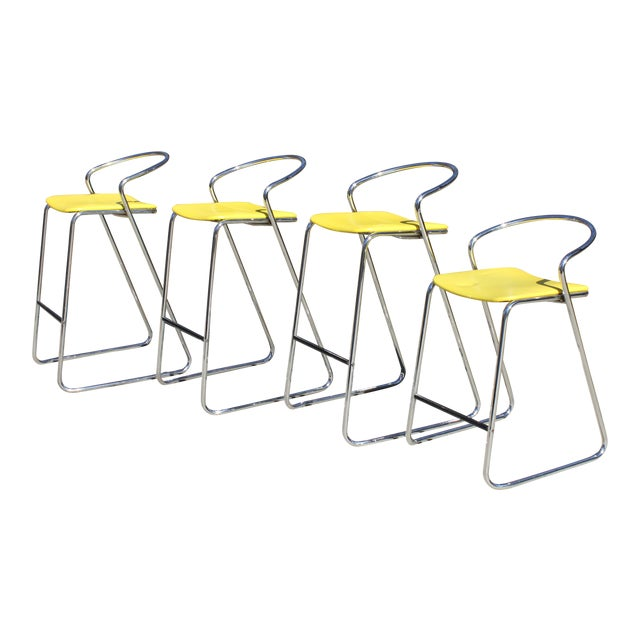 This listing is for a set of 3 bar stools in polished chrome with low backs and original yellow seats designed by Hank...