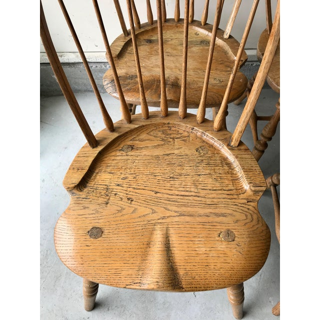 Up for sale are a set of four perfectly worn antique windsor chairs with beautifully warm antiquing. Made in the early...