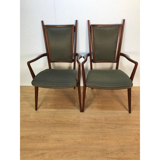 Four Vladimir Kagan dining chairs, consisting of two-arm and two side chairs, newly upholstered. Armchairs: 39.5 in H x 24...