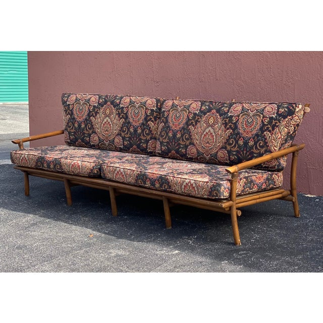 Super fabulous vintage long bamboo sofa. Done in the manner of John Wisner for Ficks Reed. Extra long with deep seats....