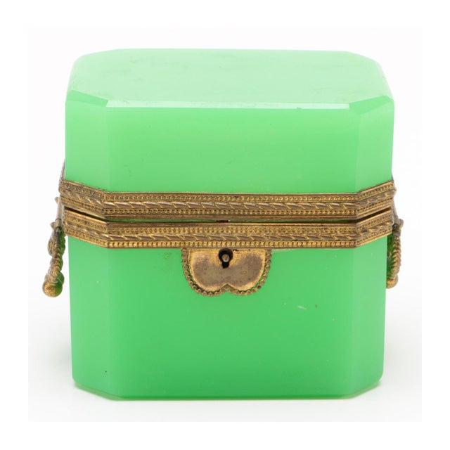A fine French 19th century apple green opaline glass box with gilt brass mounts. The box retains its original key and is...