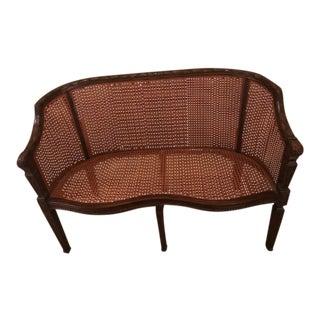 Theodore Alexander Mahogany and Cane Settee For Sale
