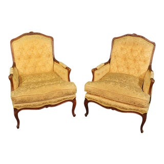 Pair of French Louis XV Style Carved Walnut Bergere Lounge Chairs For Sale