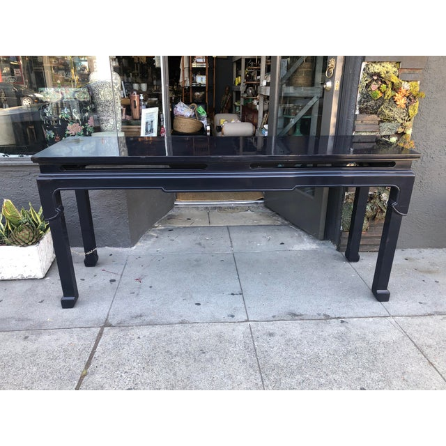 This vintage chinoiserie console table featuring its original black lacquer is perfect behind a sofa or placed in an...
