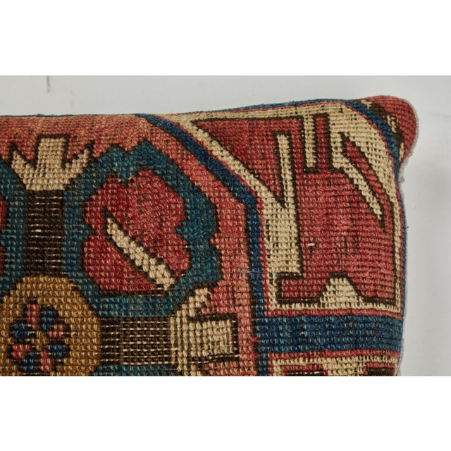 Rug fragment showing centre medallion of Kazak Caucasian tribal rug. Backed with hand woven Indian khadi cotton. Zipper...