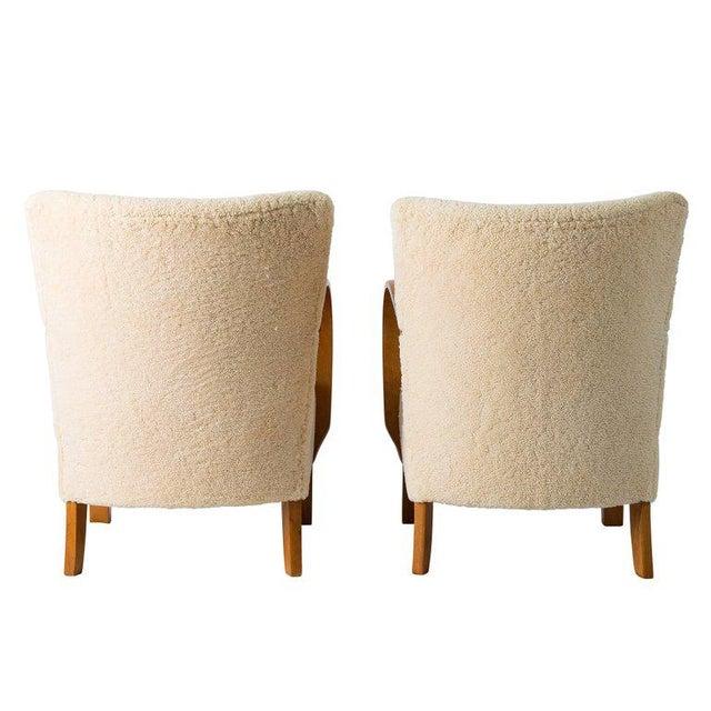 Wood Pair of Scandinavian Sheepskin Lounge Chairs For Sale - Image 7 of 9