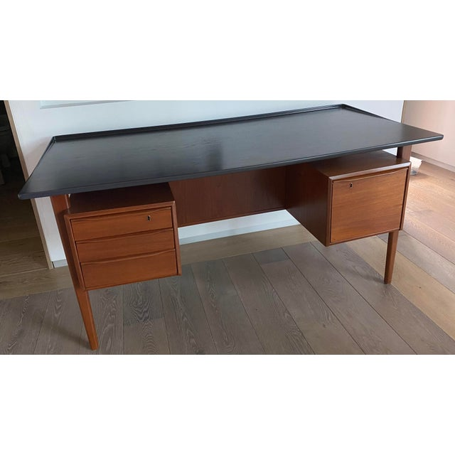 This gorgeous Mid-Century modern, teak desk was designed by Peter Løvig Nielsen and made in Denmark. This desk has a...