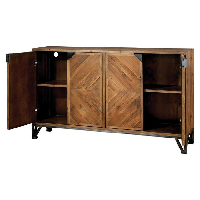 I love the metal base on this solid fir cabinet. It is made from 100% reclaimed wood, featuring a beautifully pieced...