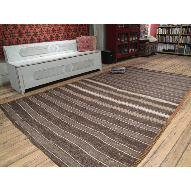 A simple old tribal floor cover from Southeastern Turkey woven with a mixture and wool and goat hair in alternating...