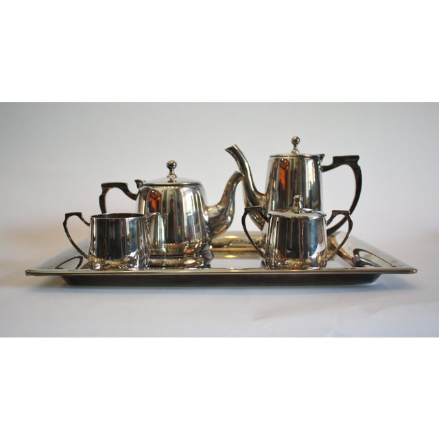 "Silver plated tea and coffee service includes coffee pitcher 6""h x 8""l x 3""w tea pot 4""h x 8""l x 4""w creamer 3""h x 4""l x..."