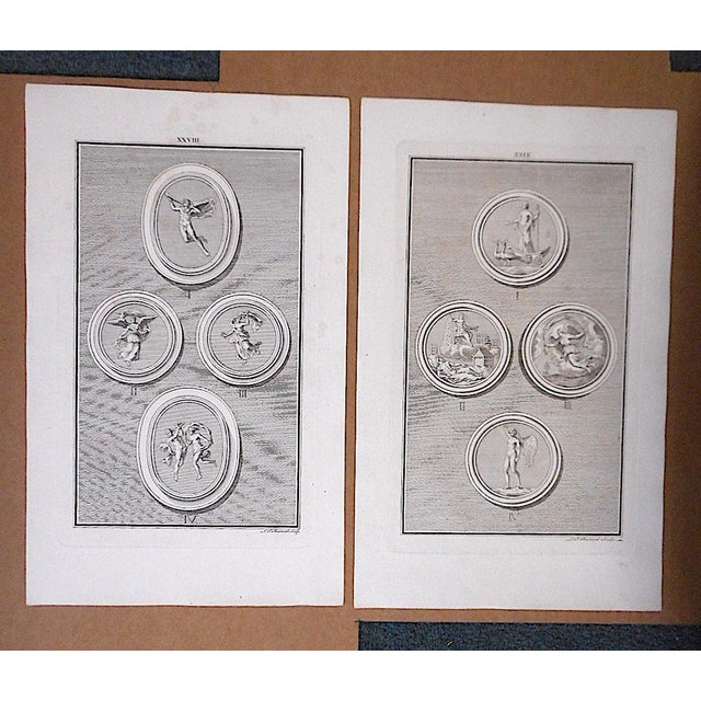This pair of authentic 18th century engravings depict medallions. Printed on handmade laid paper. These and several other...