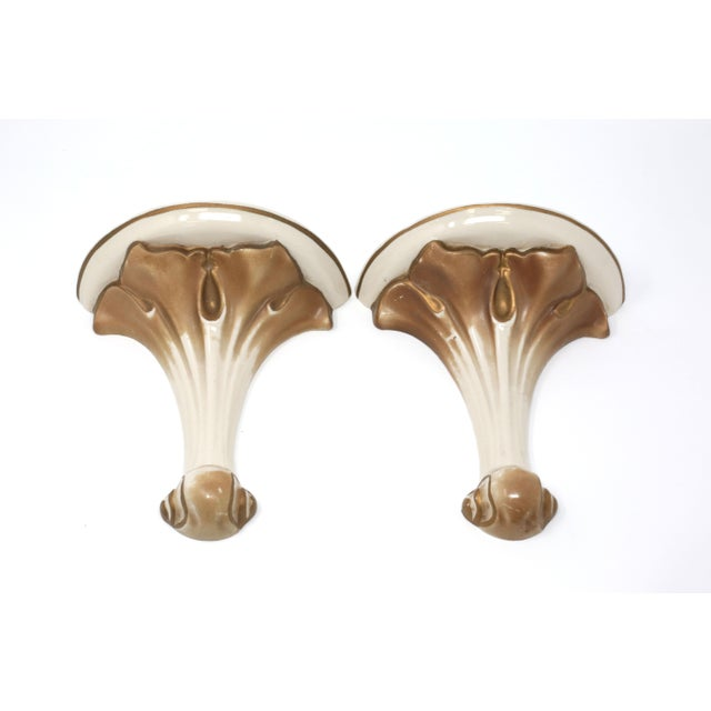 A pair of 1930's hand painted Florentine-style white ceramic wall shelves/sconces with gold gilt accents. Excellent...