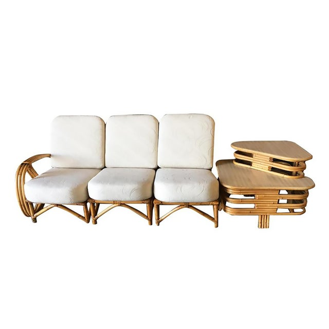 Rare 3/4 Round Pretzel arm rattan 3 seater sectional sofa with large 2 tier side table apart of the sofa. Measures: Sofa:...