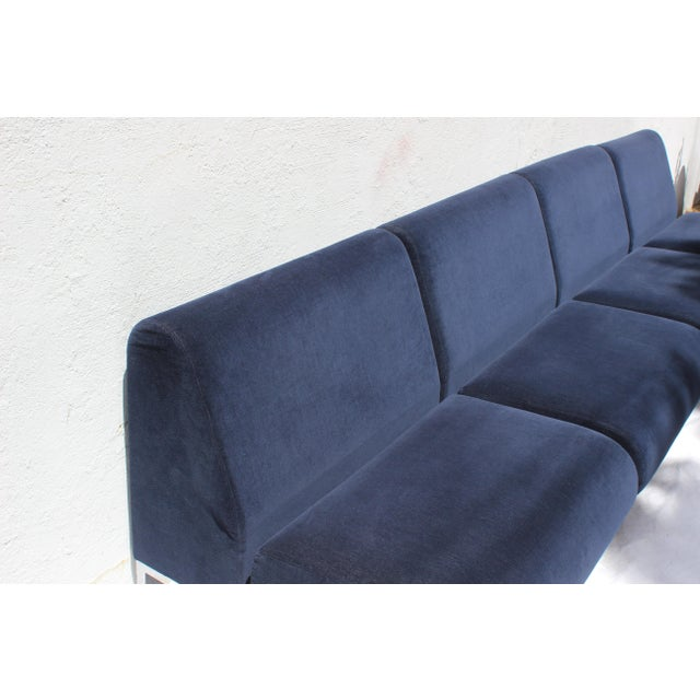 Set of four Mid-Century Modern club chairs upholstered in commercial grade Blue Velvet. They make a wonderful sectional....