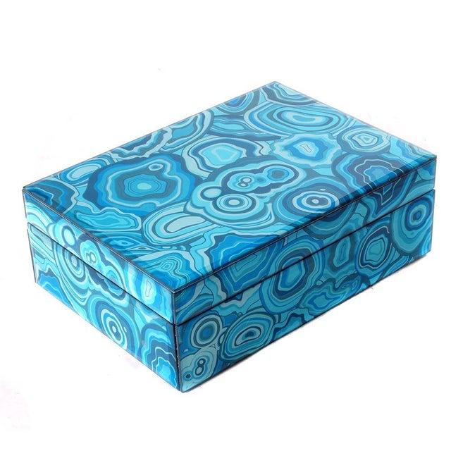 A decorative lidded box featuring a blue malachite pattern.