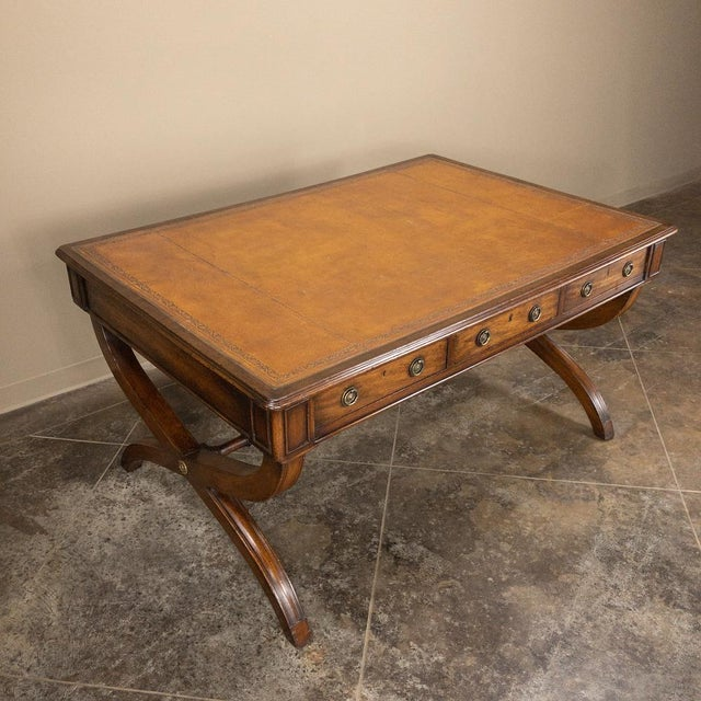 19th Century English Mahogany Leather Top Desk represents the essence of stately elegance, with crossed leg supports...