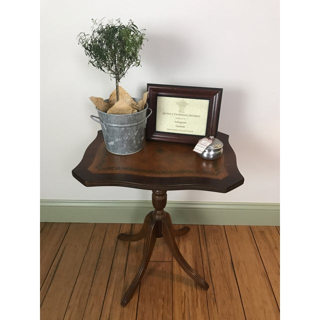 Petit antique tilt top is very unique with leather insert. Fold it down for a display piece or store until needed. It can...