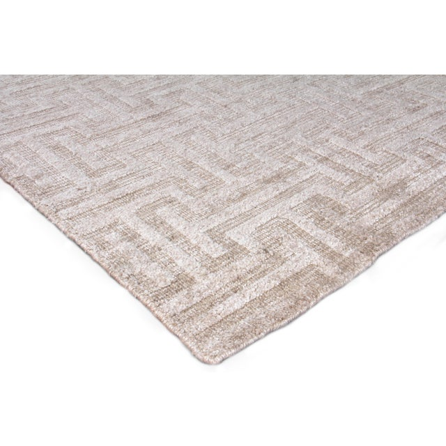 The Bazas rug shines with its subtle beauty. Handmade with fine Bamboo silk, the refined textured pattern and...