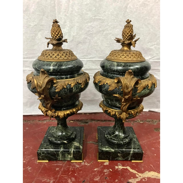 Made in France for export just after WWI, this lovely pair of green marble and bronze dorè garniture set provides a...