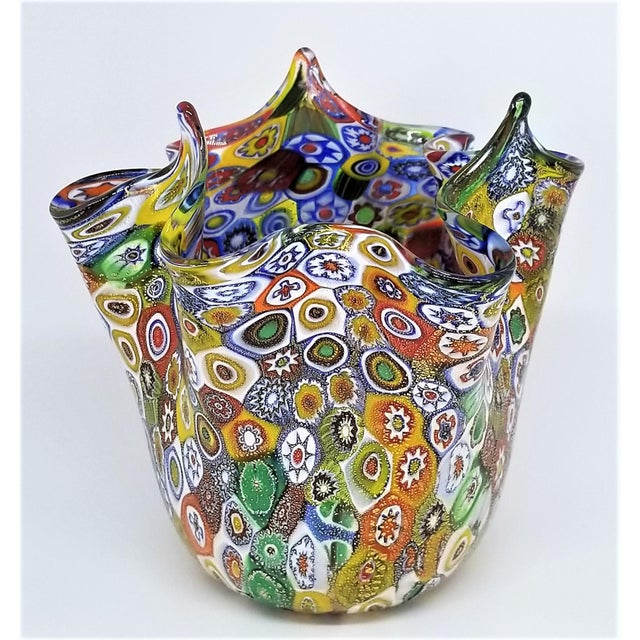 Offering an extraordinary Murano glass millifiori hankerchief vase made in Italy by Campanella, circa 1980s. This vase is...