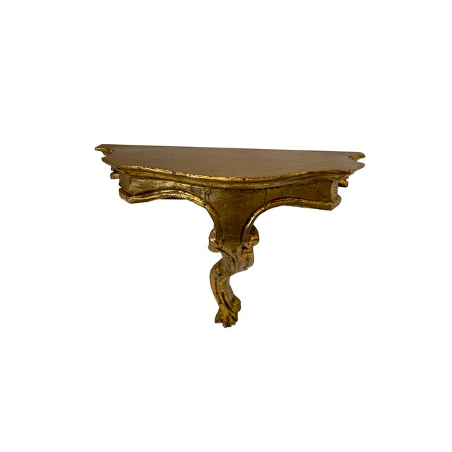 Antique Rococo style hand carved gilt wall shelf from Italy with ornate carving and hand applied gold leaf finish.