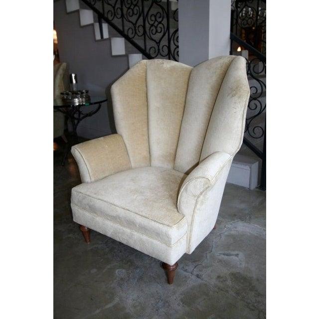 Pair of 1950's Arturo Pani lounge chairs upholstered in beige velvet on wood legs.
