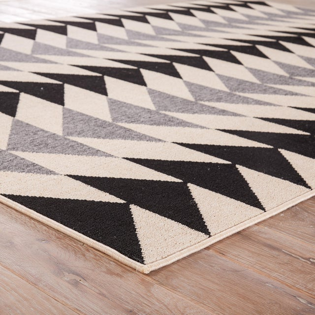 This on-trend indoor and outdoor area rug presents an eye-catching geometric pattern to high-traffic living spaces and...
