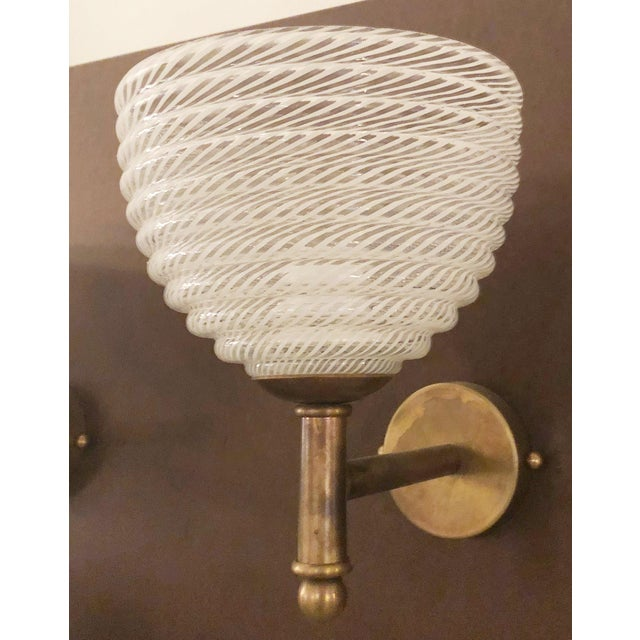 Original vintage wall lights by Barovier e Toso, with clear Murano glasses hand blown in ribbed patterns with Reticello...