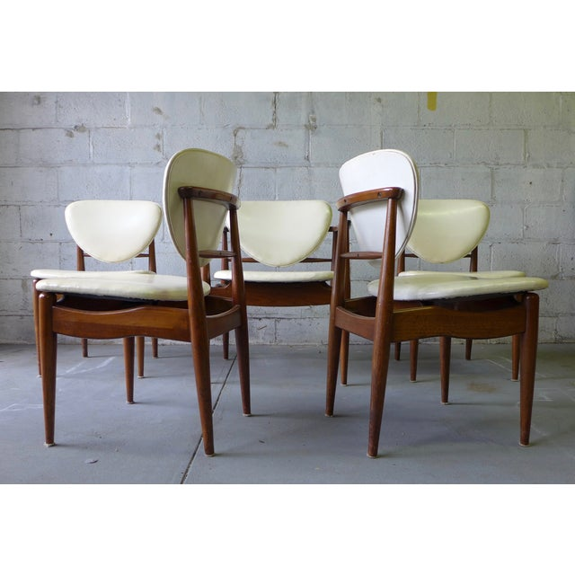 Set of six mid century modern dining chairs by John Stuart in the style of Finn Juhl. Upholstered in white naugahyde. Two...