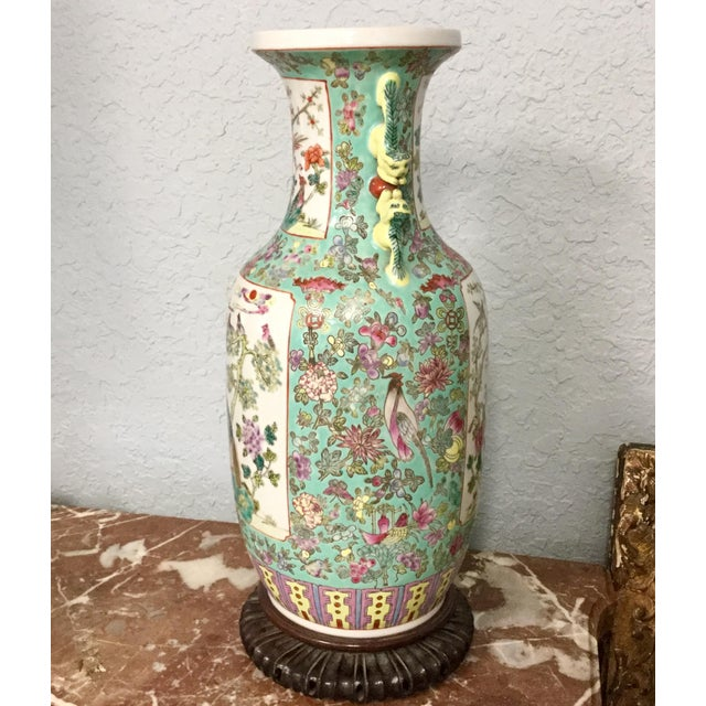 Large colorful 19th Century Chinese Export Famille Rose vase. Decorated with birds and flowers and trees in vivid crisp...