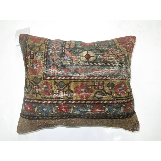Pillow made from a 19th-century antique rug with cotton back. Zipper closure and foam insert provided. Measures 17'' x 20''.