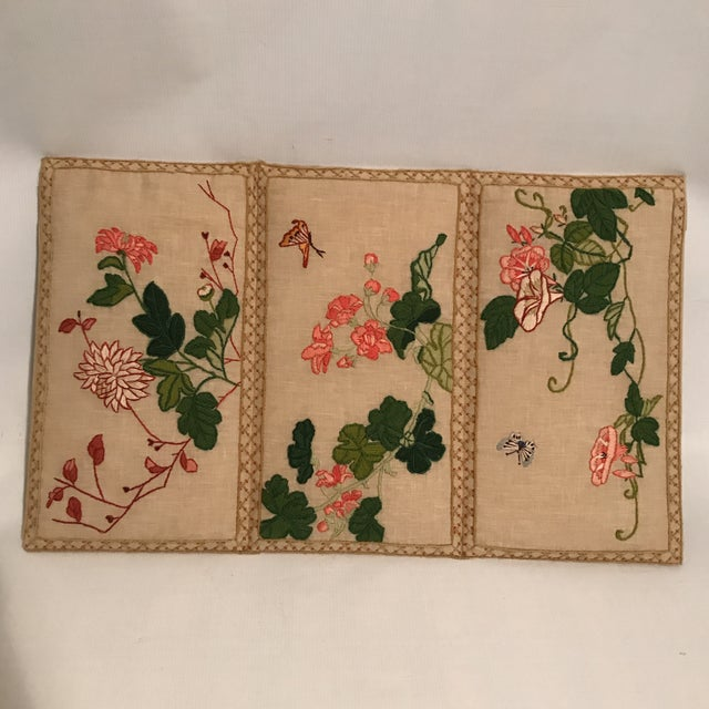 Small tabletop upholstered screen with wool crewel embroidery featuring colorful flowers and butterflies and geometric...