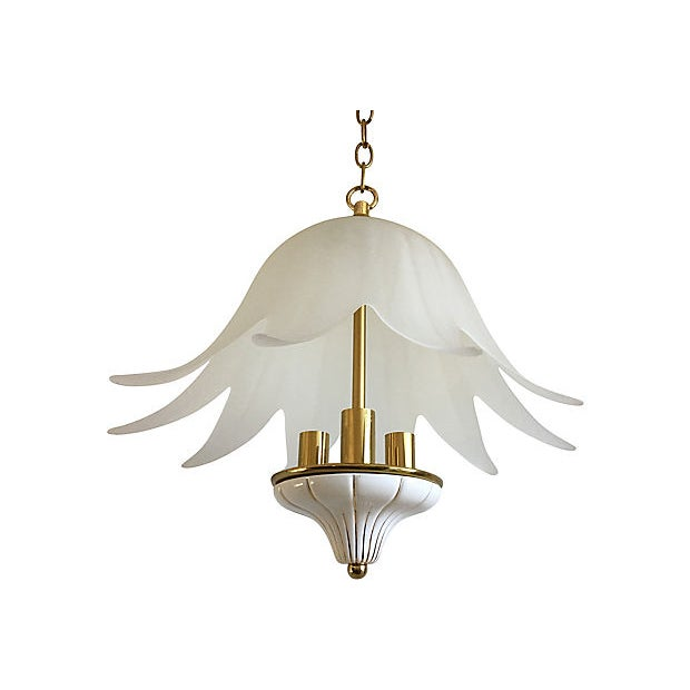 Stunning mid-century Italian lotus chandelier by F. Fabbian featuring a frosted and ribbed glass shade and a gilded and...
