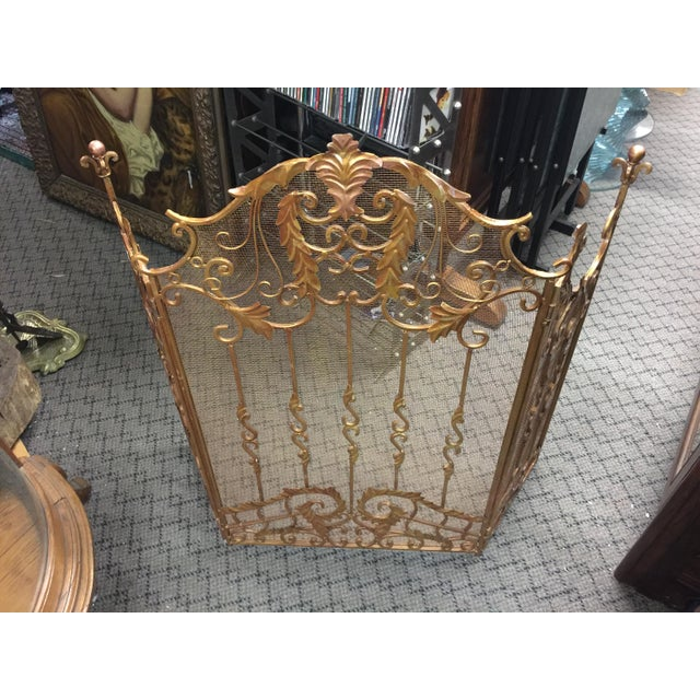 Ornate fireplace screen, French style, Circa 1920, made of wrought iron, In very good condition, but it does have two...