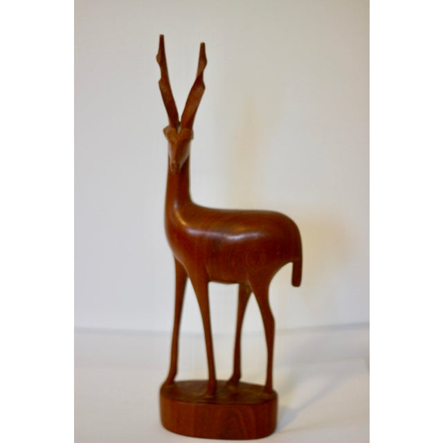 Sleek teak gazelle/antelope figurine. Hand carved.