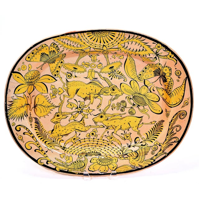 A large and impressive early 20th century 'Fantasia' patterned platter with long tailed pheasant, African gazelle and...