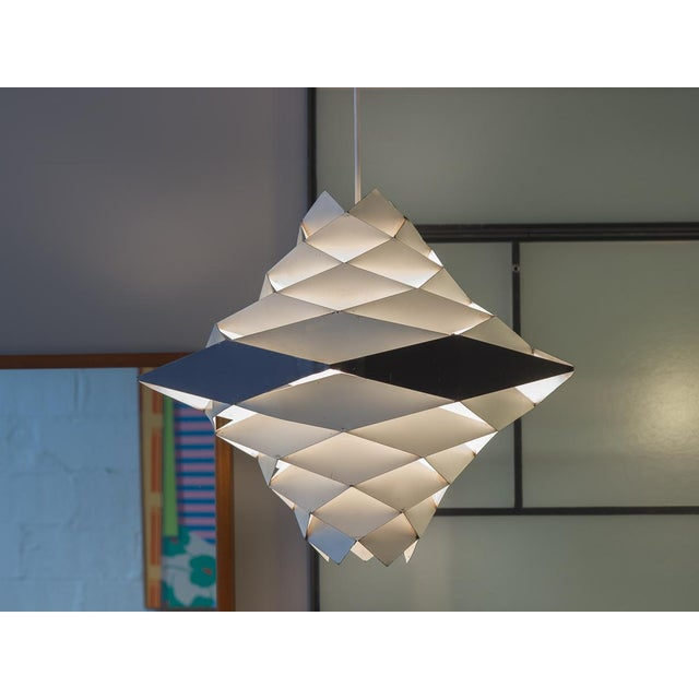 Obscure Symfoni Pendant Light designed by Preben Dahl for Hans Folsgaard. Spectacular geometric hanging pendant has rings...