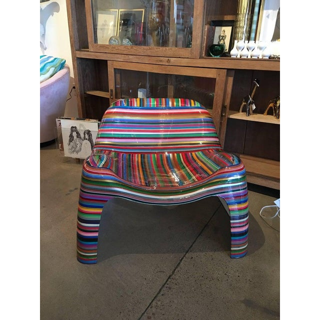 This iconic midcentury chair has been painted by the Brazilian artist, Mauro Oliveira. The paint texture is layered and...
