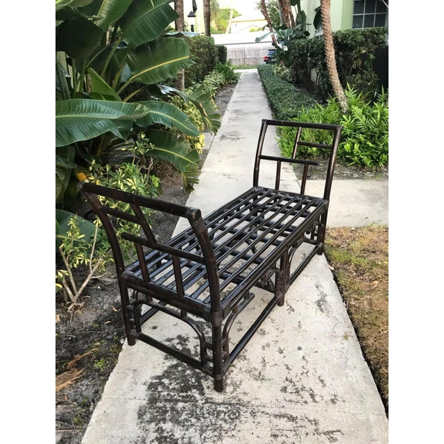 This is a great looking rattan bench with geometric fretwork. The arms wing out. This is the original color finish which...