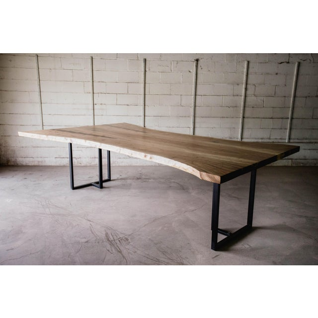 This live edge siberian elm slab table can be used as a conference table or large dining room table. This is a unique 2...