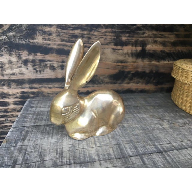 This adorable little brass rabbit bunny figurine has his long ears perked up and a sweet little expression on it's face....
