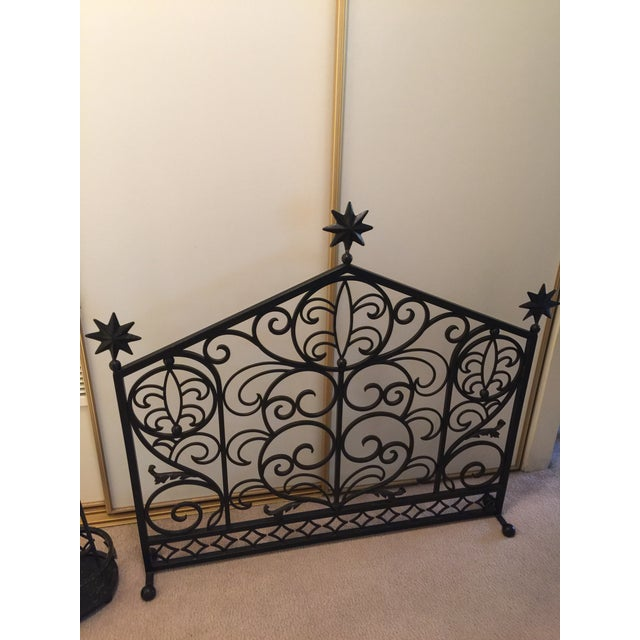 A stunning scrolled iron fireplace screen with three 8 point star finials on top! Wish upon a Star while watching the fire...